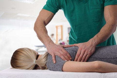 Chiropractic diagnosing the shoulder pain of the patient