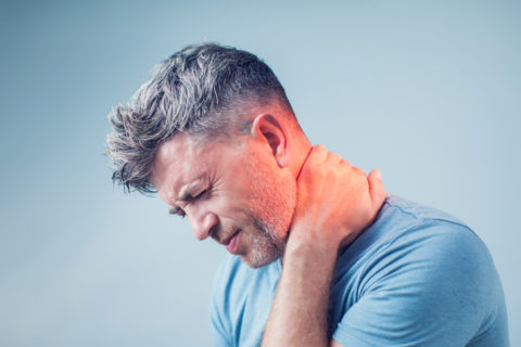 A man suffering from neck pain